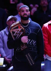 Drake Courtside With WWE Title