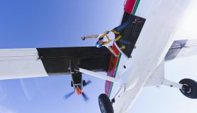 Parachutists jumping from airplane